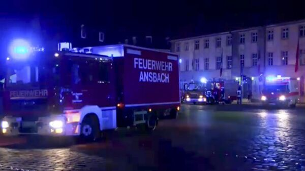 In this image taken from video fire trucks and ambulances stand in the city center of Ansbach near Nuremberg, southern Germany, Monday morning, July 25, 2016, after a man was killed when an explosive device he was believed to be carrying went off near an open-air music festival, injuring 12 others. - Sputnik International