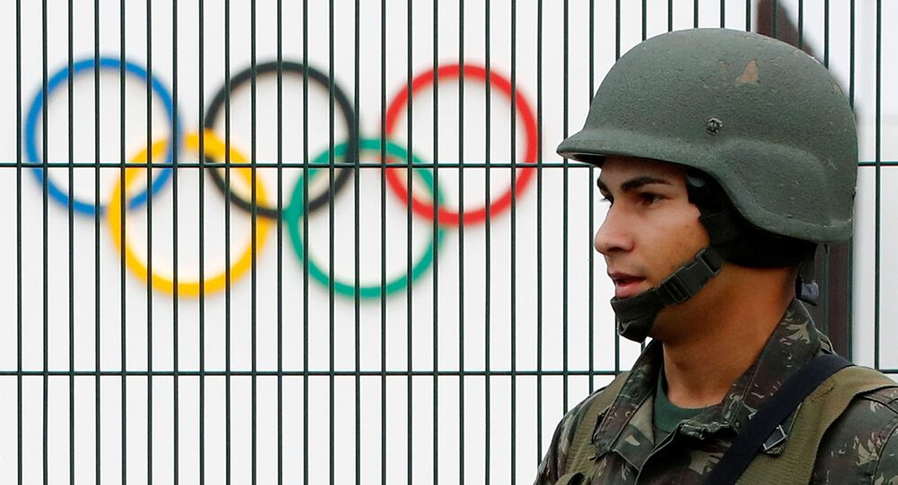 A Brazilian military police soldier patrols at the security fence outside the 2016 Rio Olympics Park in Rio de Janeiro, Brazil, July 21, 2016.