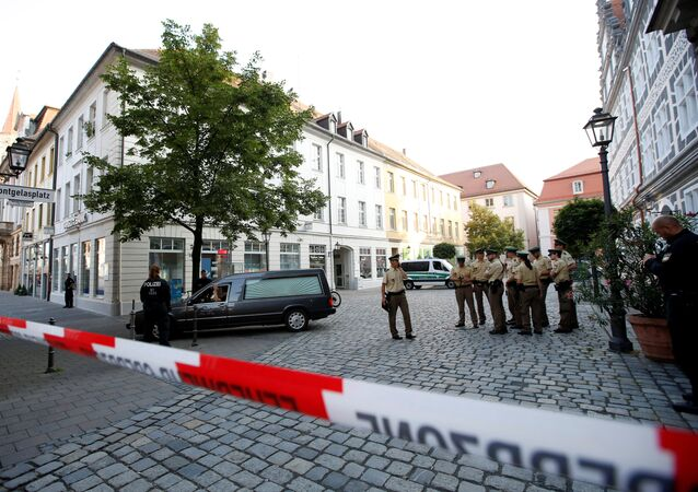 A hearse leaves the area after an explosion in Ansbach near Nuremberg, Germany, July 25, 2016.
