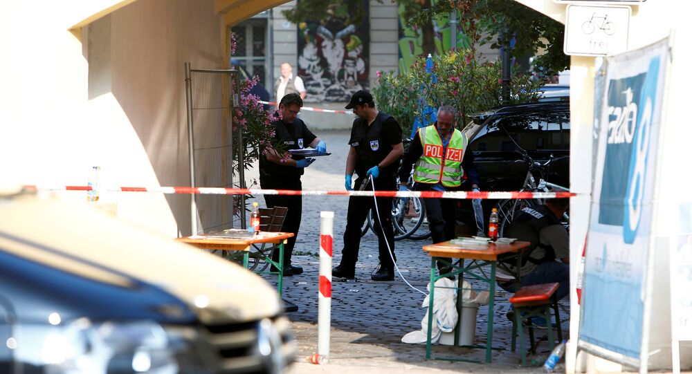 Police secure the area after an explosion in Ansbach, Germany, July 25, 2016.