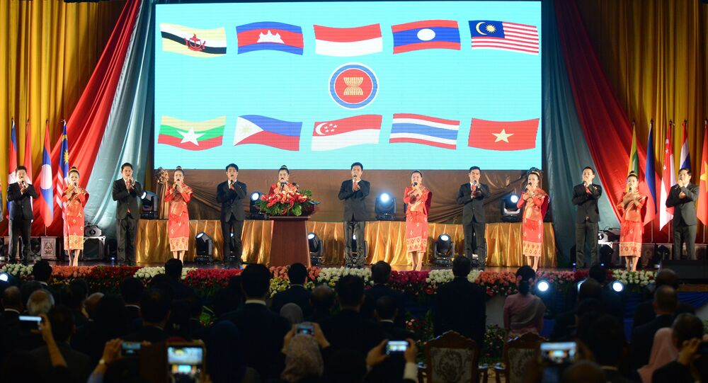 Delegates and performers sing the ASEAN anthem during the opening ceremony of the Association of Southeast Asian Nations' (ASEAN) 49th annual ministerial meeting in Vientiane on July 24, 2016.