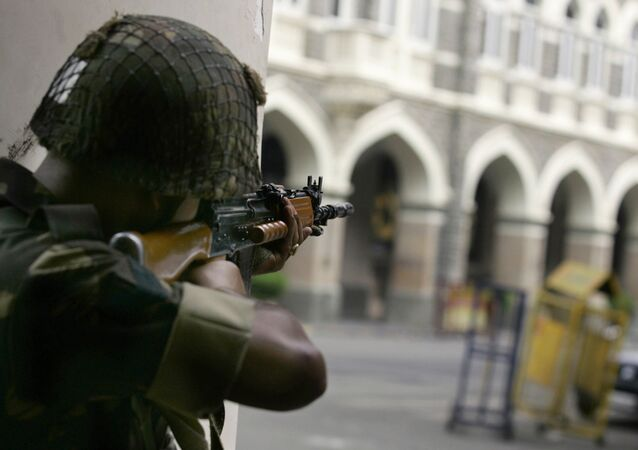 An Indian soldiers aims at Taj Mahal Hotel where suspected militants are holed up during an assault in Mumbai, India, Friday, Nov. 28, 2008.
