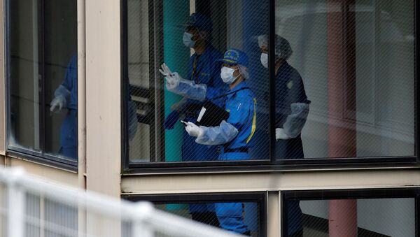 Police officers investigate at a facility for the disabled, where a deadly attack by a knife-wielding man took place, in Sagamihara, Kanagawa prefecture, Japan, July 26, 2016. - Sputnik International