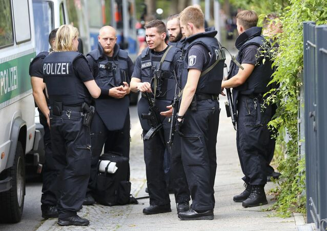 Special police stand outside the university clinic in Steglitz, a southwestern district of Berlin, July 26, 2016 after a doctor had been shot at and the gunman had killed himself.