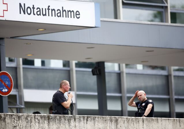 Police stand outside the university clinic in Steglitz, a southwestern district of Berlin, July 26, 2016 after a doctor had been shot at and the gunman had killed himself.