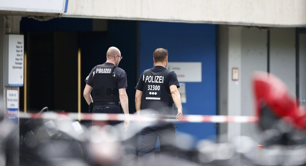 Police walks at the university clinic in Steglitz, a southwestern district of Berlin, July 26, 2016 after a doctor had been shot at and the gunman had killed himself.