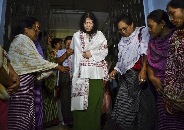 In this Wednesday, Aug. 20, 2014 photo, Irom Sharmila, center, walks out of a security ward after her release in Porompal district, in Imphal, India.