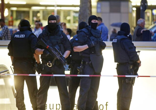 Special forces police officers stand guard at an entrance of the main train station, following a shooting rampage at the Olympia shopping mall in Munich, Germany July 22, 2016