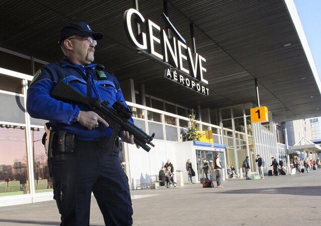 An armed policeman patrols on December 12, 2015 at Geneva Airport in Geneva