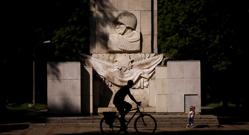 A man rides a bike in front of the monument of the Gratitude for the Soviet Army Soldiers in Warsaw, Poland 23 May 2016