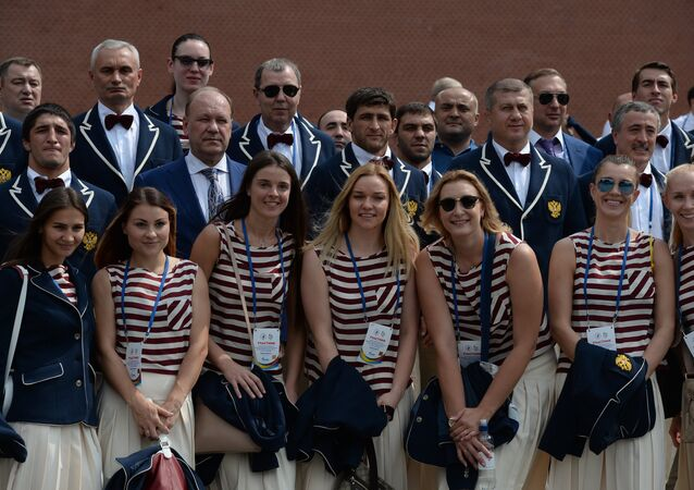 Russian Olympic team lay flowers at Eternal Flame in Alexander Garden