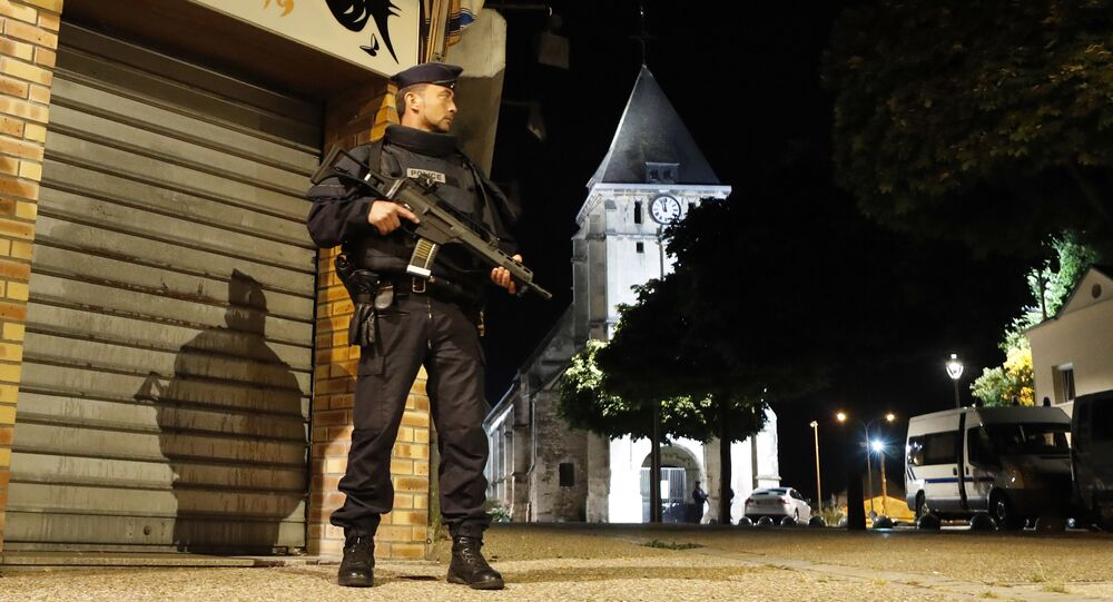 French riot police guards the street to access the church where an hostage taking left a priest dead in Saint-Etienne-du-Rouvray, Normandy, France, Tuesday, July 26, 2016