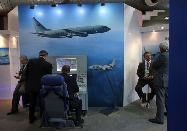 A foreign delegate sits on a mobile console for the P-81 maritime reconnaissance and anti-submarine warfare aircraft at the Boeing pavilion, during the 8th International Land and Naval Defense system exhibition, in New Delhi, India (File)