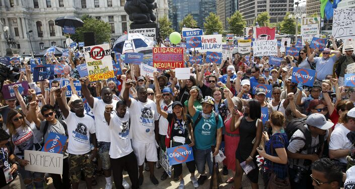 Supporters with Black Men for Bernie raise their fists for former Democratic presidential candidate Bernie Sanders during the 2016 Democratic National Convention on July 27, 2016 in Philadelphia, Pennsylvania.