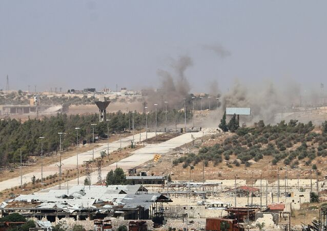 Smoke billows near Castello road leading to Bani Zeid during an operation by Syrian government forces to retake control of the rebel-held district of Leramun, on the northwest outskirts of Aleppo, on July 26, 2016