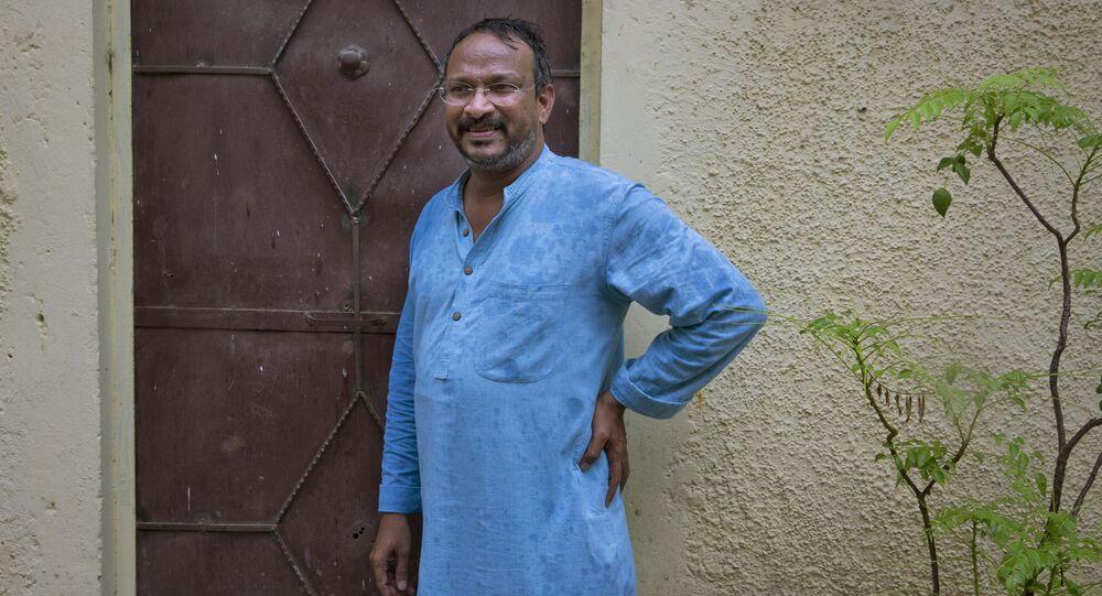 India's Bezwada Wilson, who is among the six recipients of this year's Ramon Magsaysay Award, waits to enter the Safai Karmachari Andolan (SKA) office in New Delhi, India, Wednesday, July 27, 2016