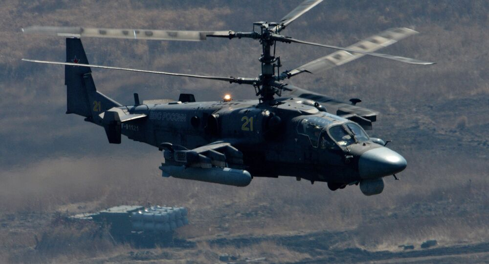 Ka-52 Alligator attack helicopter and Bal coastal missile system during bilateral drill of the Pacific Fleet's naval infantry brigade and the motor-rifle brigade of the 5th Combined Arms Army of the Eastern Military District
