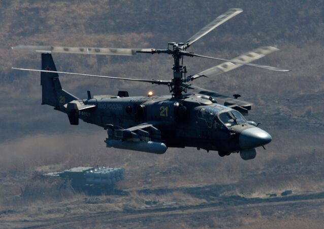 Ka-52 Alligator attack helicopter and Bal coastal missile system during bilateral drill of the Pacific Fleet