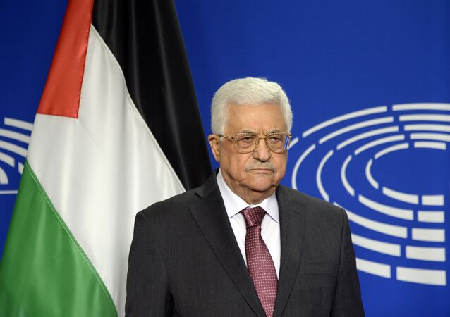 President of the Palestinian National Authority Mahmud Abbas poses for photographs at the European Parliament in Brussels on June 23, 2016.