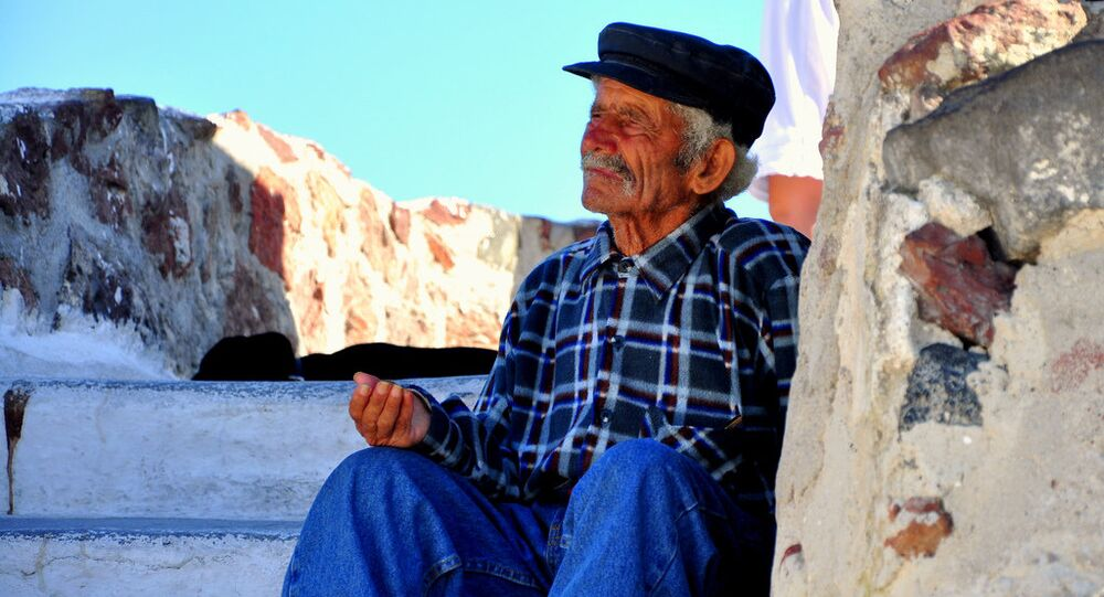 A beggar in Santorini, Greece.