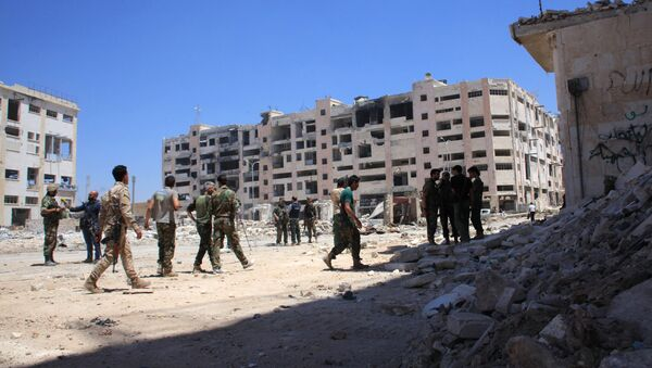 Syrian army soldiers patrol the area around the entrance of Bani Zeid after taking control of the previously rebel-held district of Leramun, on the northwest outskirts of Aleppo, on July 28, 2016 - Sputnik International