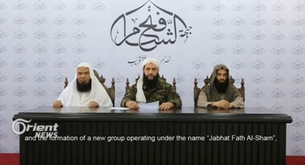 A still image taken on July 29, 2016 from an undated video shows Abu Mohamad al-Golani (C), the leader of the Syrian Islamist rebel group Jabhat Fateh al-Sham, formely known as Nusra Front, delivering a statemtent at an unknown location