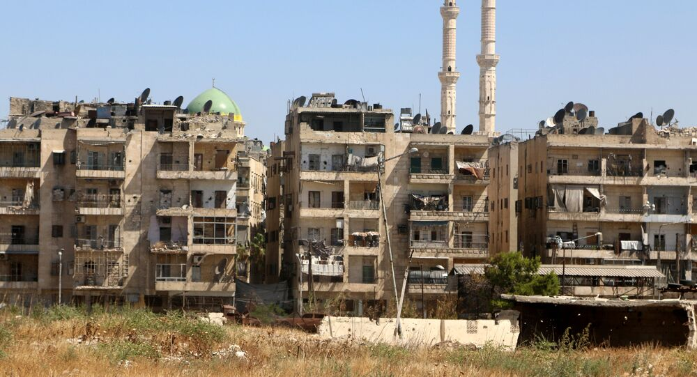 Buildings are pictured near the road, which was believed to be used by civilians to access one of the safe exit points opened for civilians intending to leave rebel-held areas, in Aleppo's Bustan al-Qasr, Syria July 29, 2016