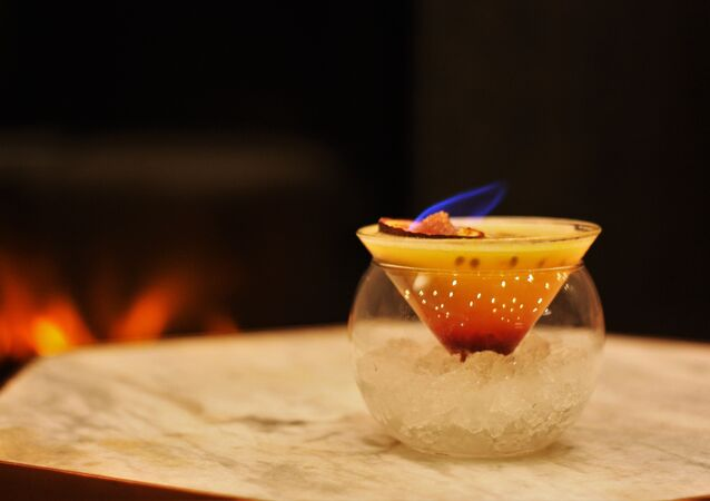 Red/Charmander: 25ml Belvedere Vodka, 45ml Passion Fruit Puree, 5ml Gomme Syrup, 10ml Grenadine. Topped with a flaming Passion Fruit.