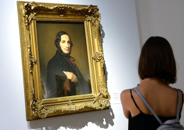 A visitor is seen near the painting A portrait of Ivan Aivazovsky by Alexei Tyranov displayed at the Ivan Aivazovsky. 200th Birthday exhibition at the Tretyakov Gallery on Krymsky Val in Moscow