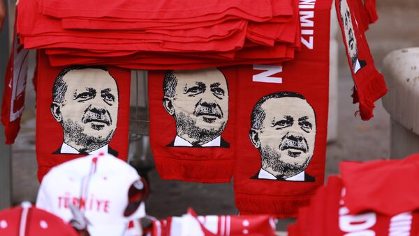This picture taken on July 25, 2016, shows scarves with the effigy of Turkish President Recep Tayyip Erdogan a rally against the military coup in Ankara - Sputnik International