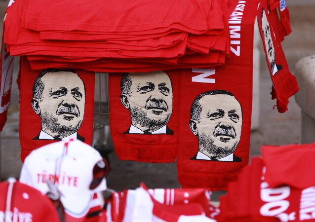 This picture taken on July 25, 2016, shows scarves with the effigy of Turkish President Recep Tayyip Erdogan a rally against the military coup in Ankara