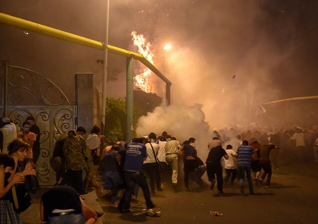 Protesters clash with police in the street near the traffic police building seized by opposition, Yerevan