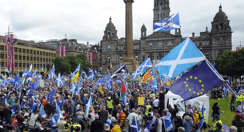 Pro-Scottish Independence supporters with Scottish Saltire flags and EU flags among others rally in George Square in Glasgow, Scotland on July 30, 2016 to call for Scottish independence from the UK
