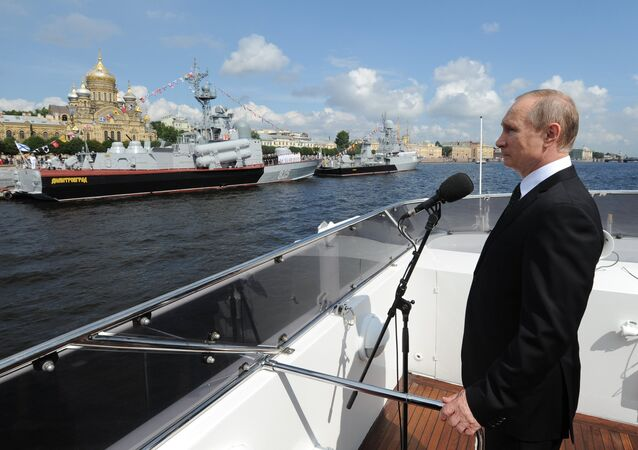 Russian President Vladimir Putin on the Serafim Sarovsky boat during a parade of ships held to celebrate the Navy Day in St. Petersburg