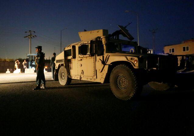 Afghan policemen keep watch near the site of a blast in Kabul, Afghanistan August 1, 2016