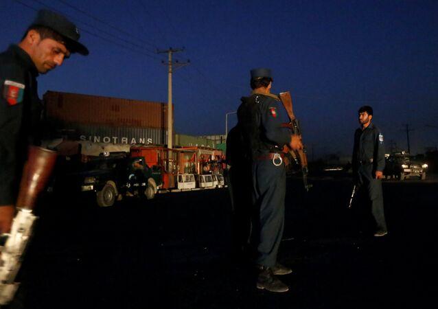 Afghan policemen keep watch near the site of a blast in Kabul, Afghanistan August 1, 2016.