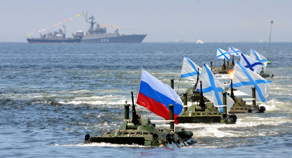 Russian amphibious vehicles drive in formation during a rehearsal for the Navy Day parade in the far eastern port of Vladivostok, Russia