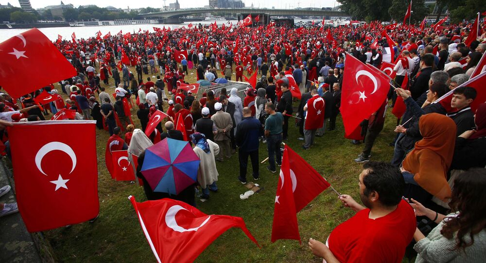 Supporters of Turkish President Tayyip Erdogan wave Turkish flags during a pro-government protest in Cologne, Germany July 31, 2016.