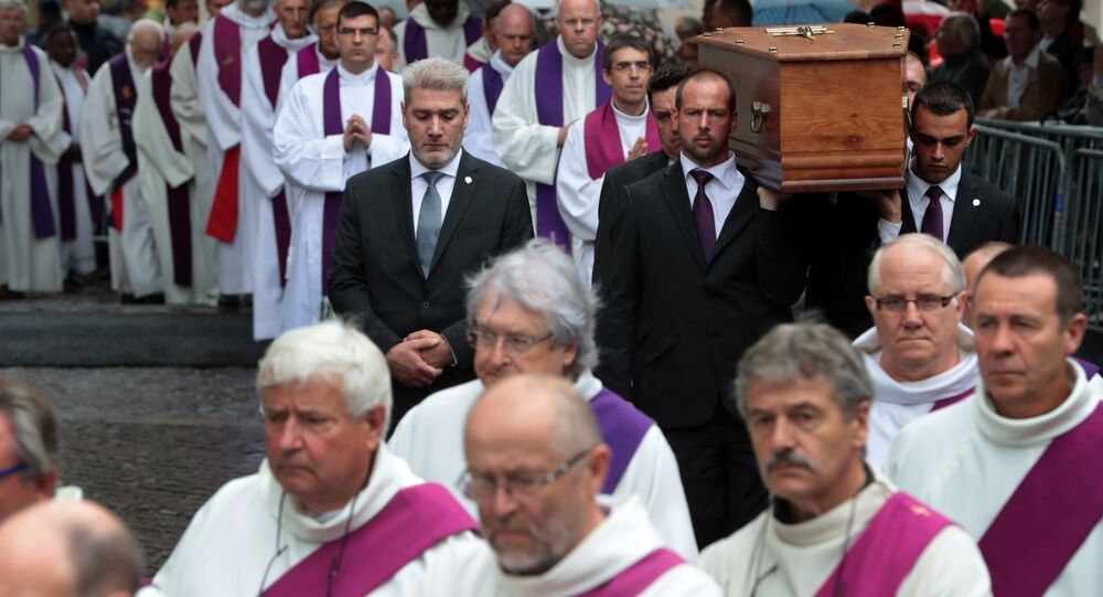 Pallbearers carry the coffin of the priest Jacques Hamel as they enter in Rouen's cathedral during the funeral of the priest who was killed in a church in Saint-Etienne-du-Rouvray on July 26 during a hostage-taking claimed by Islamic State group