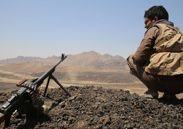 A Yemeni tribesman from the Popular Resistance Committees, supporting forces loyal to Yemen's Saudi-backed President Abedrabbo Mansour Hadi, holds a position near the 312 Brigade military camp. (File)