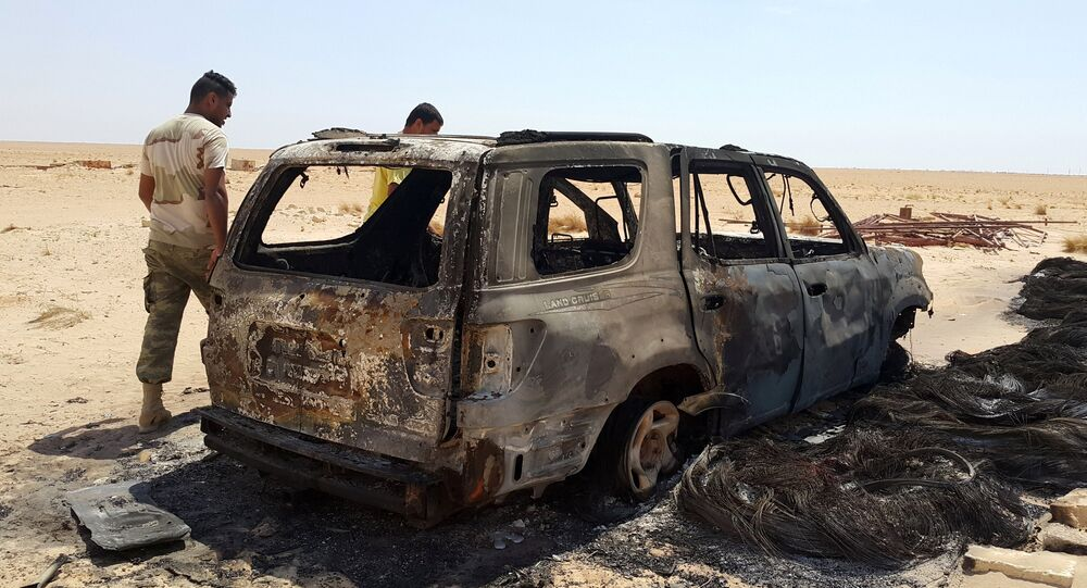 A suicide bomber attacked a group of Libyan servicemen in the country's second largest city of Benghazi, killing eight people and injuring 16, local media reported Tuesday.