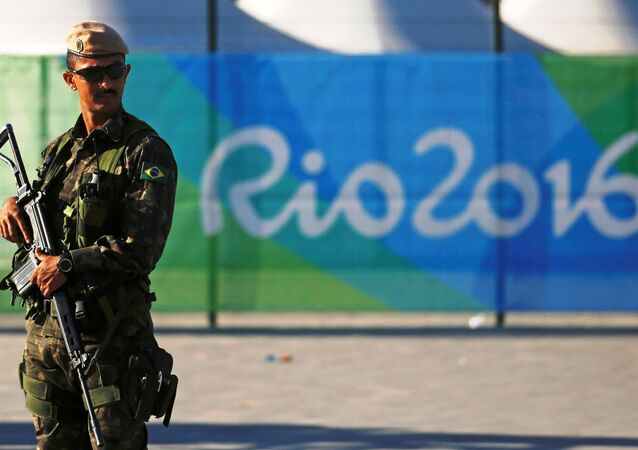 A special police forces officer stand guard outside the Olympic Park less than two weeks before the start of the Rio 2016 Olympic Games in the Barra da Tijuca neighborhood of Rio de Janeiro, Brazil, July 24, 2016.