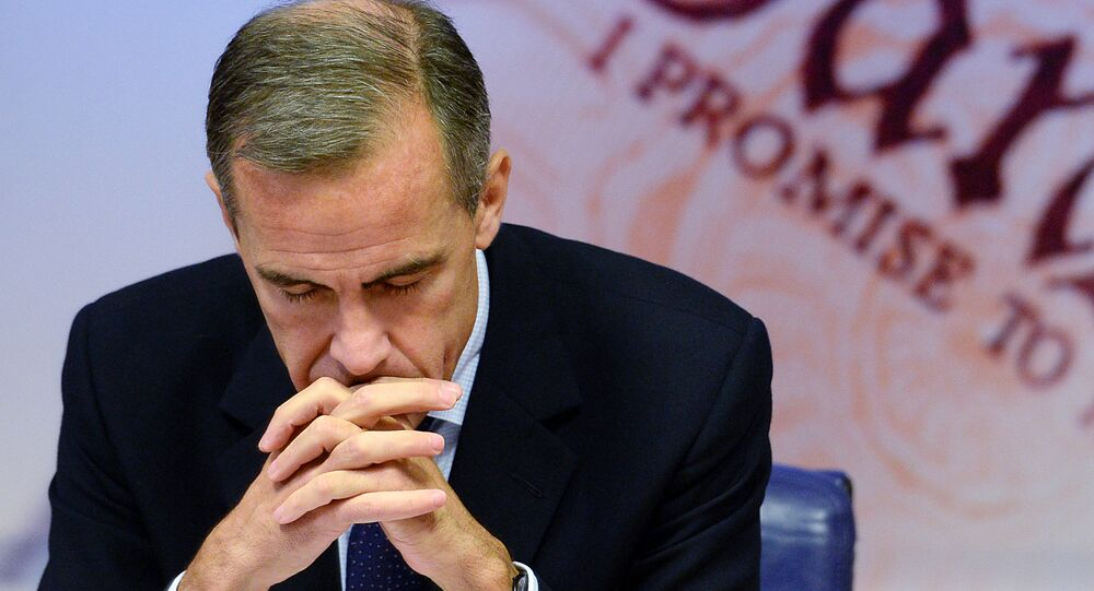 Governor of the Bank of England Mark Carney is pictured as he addresses a quarterly inflation report press conference at the Bank of England in London, on November 12, 2014.