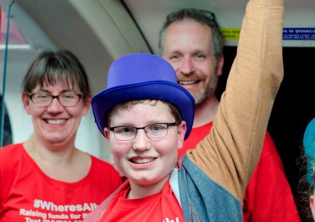 Alasdair Clift  travels the tube with his parents in memory of his brother
