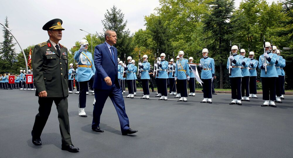 Turkey's President Tayyip Erdogan reviews a guard of honour as he is accompanied by Chief of Staff General Hulusi Akar upon his arrival to the Chief of Staff Headquarters in Ankara, Turkey, August 3, 2016.