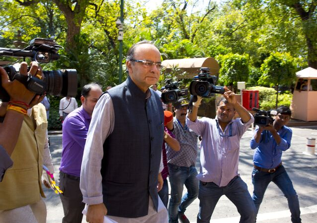 Indian Finance Minister Arun Jaitley arrives at the parliament house in New Delhi, India, Aug. 3, 2017. The government on Wednesday is likely to present the goods and services tax or GST bill in the upper house of the parliament, which if enacted will replace central and state taxes with a single GST creating a national market for the country. The reform is expected to raise India's GDP by up to 1.7 percent.