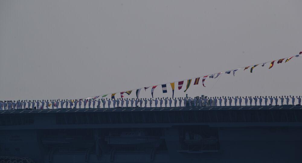 Indian sailors on Vikramaditya aircraft carrier salute.