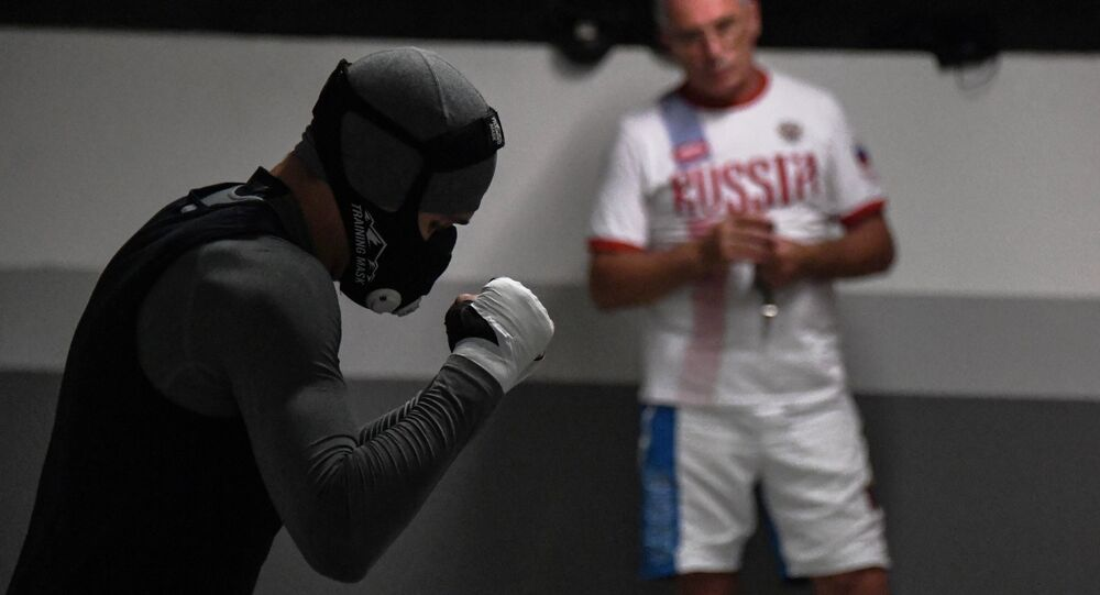 Russian boxer Vitaly Danaitsev training on the parking level of the Russian team's accommodation in the Olympic village in Rio de Janeiro
