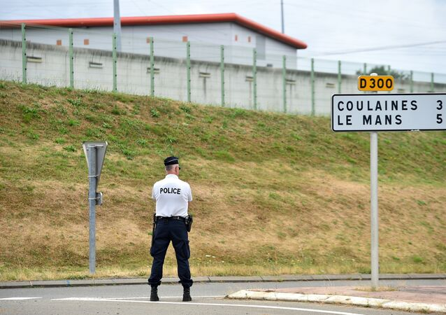 A police officer stands outside the prison of Le Mans Les Croisettes in Coulaines, on August 4, 2016, where two people including a prison warden and an inmate are held hostage by another inmate, according to police