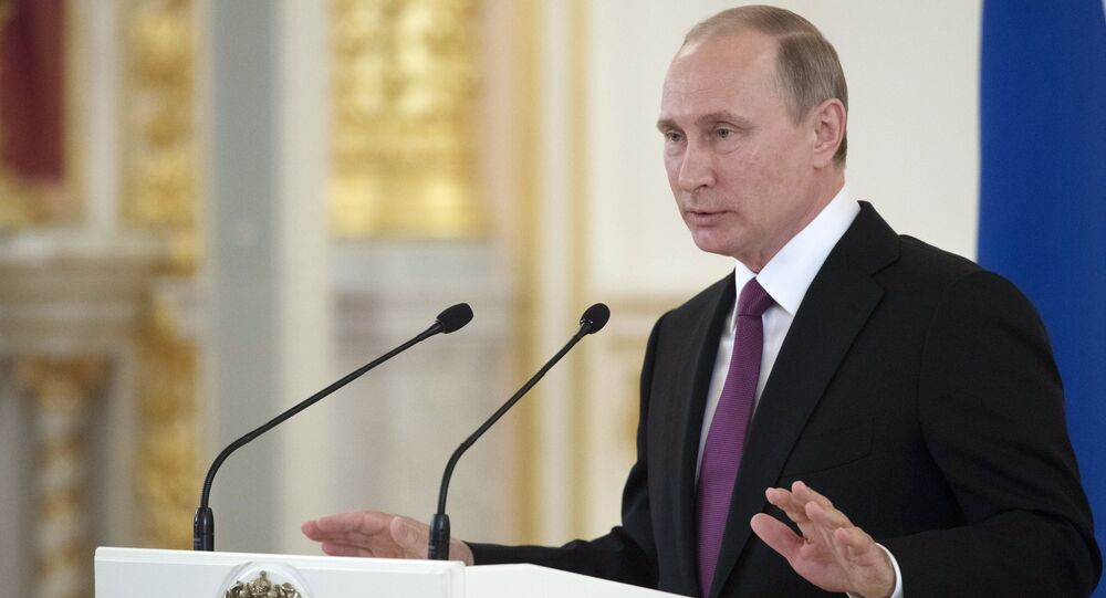 President Vladimir Putin meets with national Olympic team in Kremlin